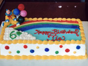 Custom Cake with Clown, Balloons, and Rainbow